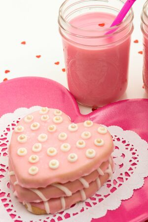 Valentine pink heart cookies stacked on a pink plate photo