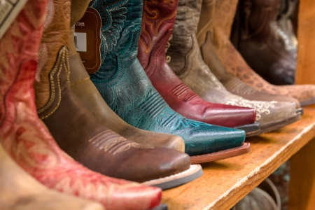 Shelf of colorful womens cowboy boots