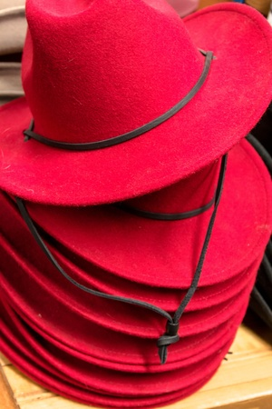 Stack of womens red cowboy hats