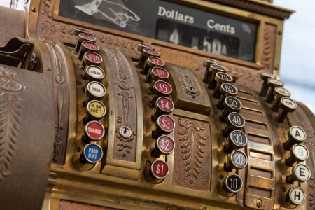 Antique cash register from the front, with view of buttons