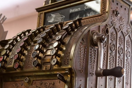 hand crank: Antique cash register from the front and side with hand crank Stock Photo