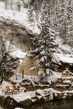 river county: Strawberry Park Hot Spings natural hot springs in winter after freshly fallen snow