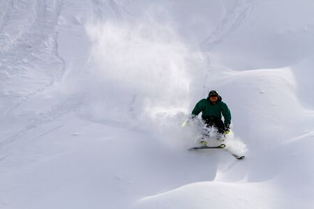 moguls: Male skier skiing down moguls in fresh powder at Ski Days during 50 Year Steamboat Springs winter celebration