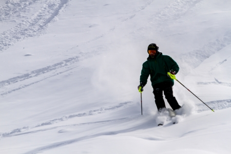 moguls: Male skier making fresh tracks on moguls at Ski Days during 50 Year Steamboat Springs winter celebration