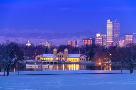 Denver Colorado skyline at sunrise, day after snow storm in winter, from City Park and Denver Museum of Science and Nature