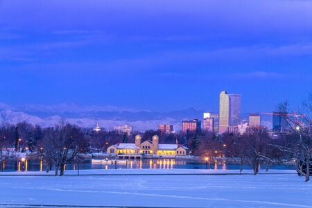 denver skyline at sunrise: Denver Colorado skyline at sunrise, day after snow storm in winter, from City Park and Denver Museum of Science and Nature