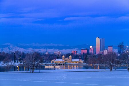 city park boat house: Denver Colorado skyline at sunrise, day after snow storm in winter, from City Park and Denver Museum of Science and Nature