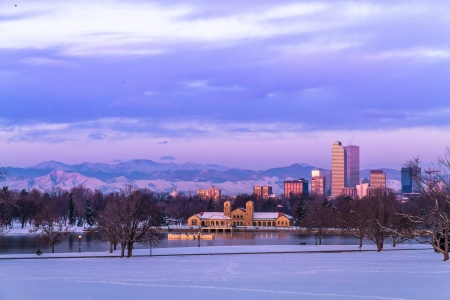 denver city park: Denver Colorado skyline at sunrise, day after snow storm in winter, from City Park and Denver Museum of Science and Nature