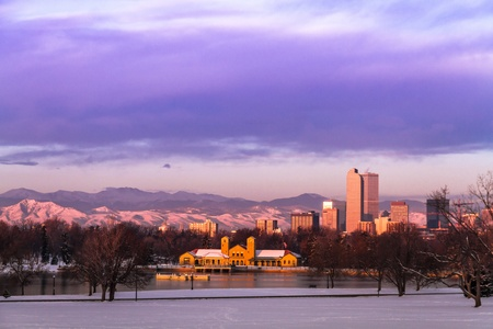 denver at sunrise: Denver Colorado skyline at sunrise, day after snow storm in winter, from City Park and Denver Museum of Science and Nature