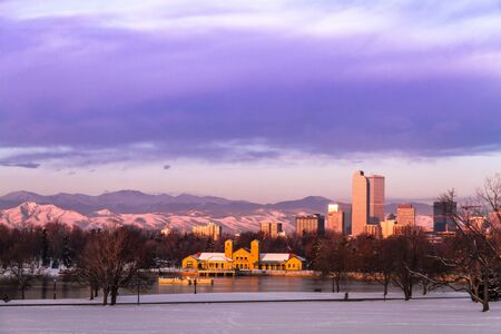 Denver Colorado skyline at sunrise, day after snow storm in winter, from City Park and Denver Museum of Science and Nature Stock Photo - 18063052