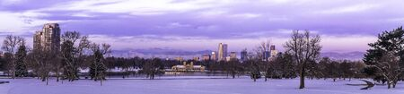 city park boat house: Panorama of Denver Colorado skyline at sunrise, day after snow storm in winter, from City Park and Denver Museum of Science and Nature