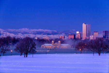 denver city park: Denver Colorado skyline at sunrise, day after winter snow storm from City Park and Denver Museum of Science and Nature Editorial