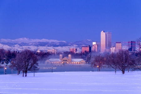 denver co: Denver Colorado skyline at sunrise, day after winter snow storm from City Park and Denver Museum of Science and Nature Editorial