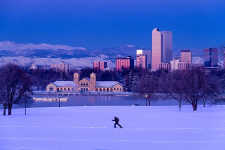 city park boat house: Denver Colorado skyline at sunrise, day after winter snow storm from City Park and Denver Museum of Science and Nature Editorial