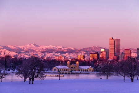 denver at sunrise: Denver Colorado skyline at sunrise, day after winter snow storm from City Park and Denver Museum of Science and Nature Editorial