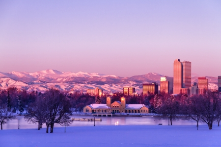 denver skyline at sunrise: Denver Colorado skyline at sunrise, day after winter snow storm from City Park and Denver Museum of Science and Nature Editorial