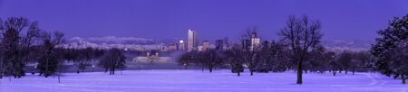 Panorama of Denver Colorado skyline at sunrise, day after winter snow storm from City Park and Denver Museum of Science and Nature photo