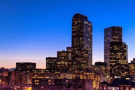 cash register building: Close up of Denver Colorado skyline at dusk during the blue hour with lighted buildings and streets Editorial