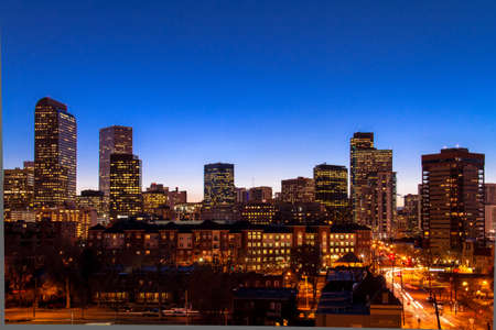capital of colorado: Denver Colorado skyline at dusk during the blue hour with lighted buildings and streets
