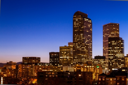 denver skyline: Close up of Denver Colorado skyline at dusk during the blue hour with lighted buildings