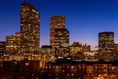 cash register building: Close up of Denver Colorado skyline at dusk during the blue hour with lighted buildings