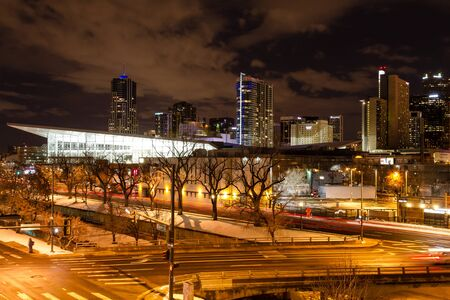 Illuminated Colorado Convention Center and Denver Colorado skyline at night with dramatic winter night sky Stock Photo - 18328775