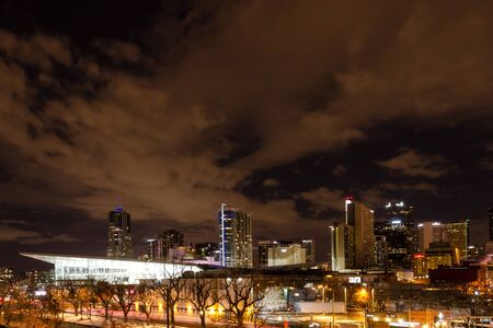Illuminated Colorado Convention Center and Denver Colorado skyline at night with dramatic winter night sky Stock Photo - 18328771