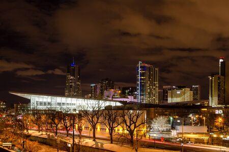 Illuminated Colorado Convention Center and Denver Colorado skyline at night with dramatic winter night sky Stock Photo - 18328774