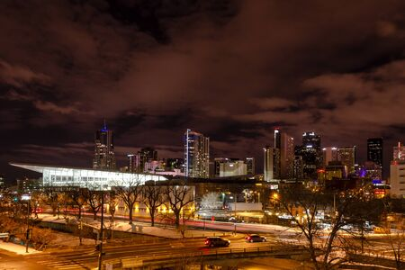 Illuminated Colorado Convention Center and Denver Colorado skyline at night with dramatic winter night sky Stock Photo - 18328772