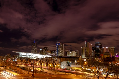 Illuminated Colorado Convention Center and Denver Colorado skyline at night with dramatic winter night sky Stock Photo - 18328769