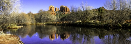 Panorama of evening sunset at Cathedral Rock at Red Rocks Crossing on Oak Creek in Sedona Arizona photo