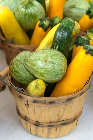 organically: Organically grown basket full of fresh vegetables for sale at local farmer market Stock Photo