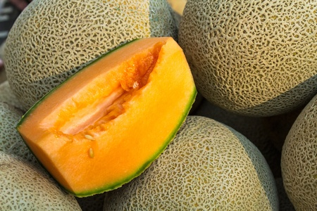 organically: Display of organically grown cantaloupe melons for sale at local farmers market Stock Photo