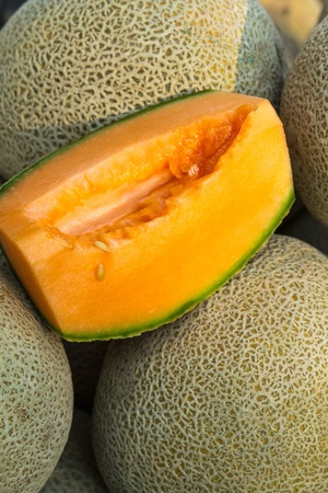 locally: Fresh locally grown display of cantaloupe melons for sale at local farmers market