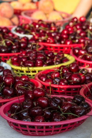 organically: Organically grown  red cherries on display in baskets at local farmer market