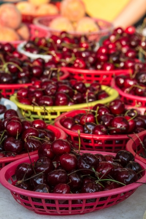 Locally grown display of red bing cherries for sale at local farmers market photo