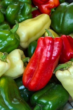 organically: Organically grown bell peppers on display in baskets at local farmer market Stock Photo