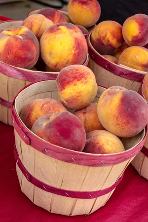 organically: Organically grown yellow peaches for sale at local farmer market
