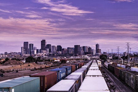 denver skyline at sunset: Denver Skyline view from city railway yards with parked freight trains on tracks