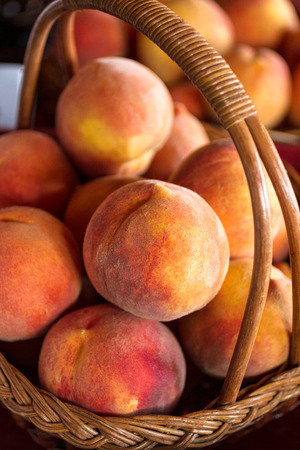 country store: Basket of fresh ripe yellow peaches at country store Stock Photo