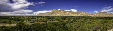 wine road: Panorama overlooking the Colorado River and the Grand Valley from Palisades CO vineyard