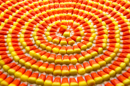 Candy corn arranged in circles on angle photo