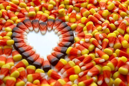 Indian corn heart among candy corn photo