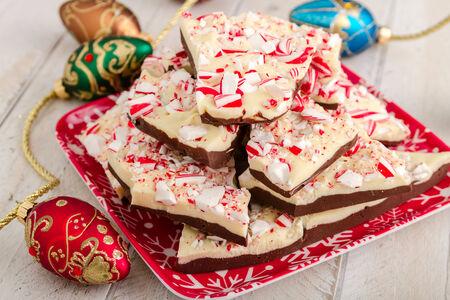 Homemade chocolate peppermint bark sitting on festive snowflake plate photo