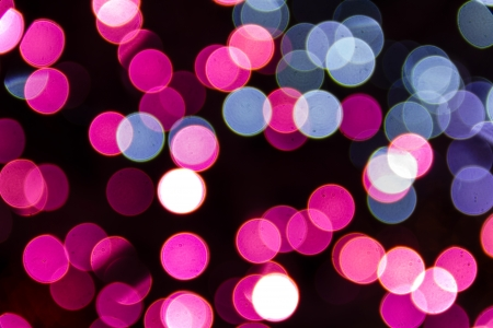 Abstract Circular Bokeh Background Of Pink And Blue Christmas Lights Stock Photo