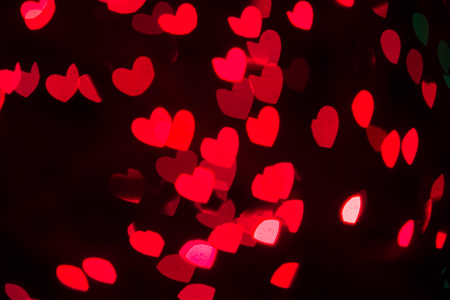 Abstract heart shaped bokeh background of red Christmas lights Stock Photo
