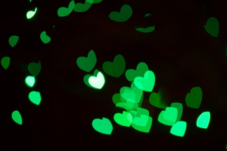 Abstract heart shaped bokeh of white Christmas lights photo