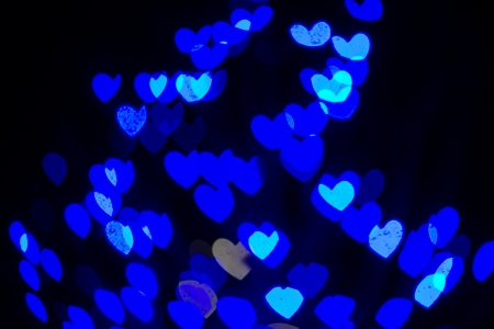 Abstract heart shaped bokeh background of blue Christmas lights photo