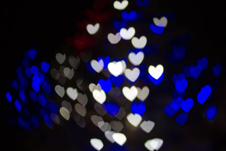 Abstract heart shaped bokeh background of blue and white Christmas lights