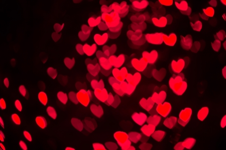 Abstract heart shaped bokeh background of red Christmas lights photo